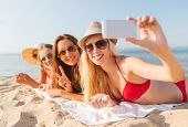 summer vacation, travel, technology and people concept - group of smiling women in sunglasses making