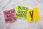 break bad habits, build good habits - motivational reminder on colorful sticky notes - self-developm