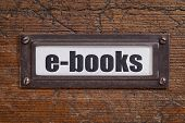 e-books  - file cabinet label, bronze holder against grunge and scratched wood