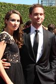 LOS ANGELES - AUG 16:  Troian Bellisario, Patrick J. Adams at the 2014 Creative Emmy Awards - Arrivals at Nokia Theater on August 16, 2014 in Los Angeles, CA