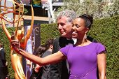 LOS ANGELES - AUG 16:  Anthony Bourdain, Aisha Tyler at the 2014 Creative Emmy Awards - Arrivals at
