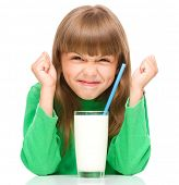 Little girl with a glass of milk, isolated over white