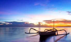 picture of traditional  - Jukung traditional bali fishing boat on sunrise near sanur beach facing the ocean - JPG