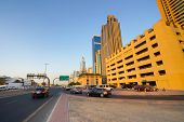 DUBAI - OCT 13: Dubai streets on October 13, 2014. Dubai is the most populous city and emirate in the UAE, and the second largest emirate by territorial size after the capital, Abu Dhabi