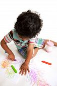 Toddler Producing Art Work with Crayons