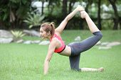 Sporty Yoga Girl Doing Exercises For Buttocks On Lawn