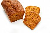 Sliced Pumpkin Bread Over A White Background
