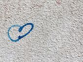 Background Of Old Stained Concrete Wall Painted With Blue Paint Heart