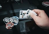 picture of poker hand  - queen and ace as a winning hand poker game - JPG