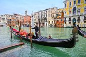 Gondola And Gondolier In Venice