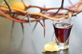 stock photo of covenant  - Taking Communion  with crown in background on easter holiday
