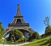 The picture was taken Fisheye lens. Huge and beautiful Eiffel Tower. At the foot of the tower is designed park with paths and pond