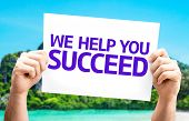 We Help You Succeed card with a beach on background