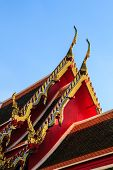 Golden stainglass on wat thai roof in sunshine