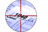 Detail closeup of current tax forms for IRS filing with crosshairs to destroy taxes