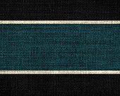 Dark jungle green and black burlap jute fabric textured background