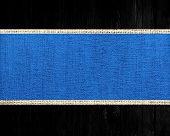 blue jute canvas banner textured with black wood background