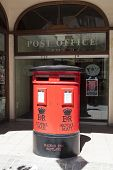 GIBRALTAR - JUNE 3, 2013: Photo of Mailbox Royal Mail post office in Gibraltar.