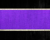 purple rustic canvas banner textured with black wood background