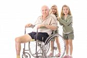 twin sisters pushing eldery man in wheelchair