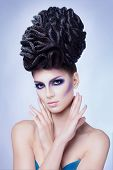 Fashion beauty portrait of sexy woman with creative hairstyle and make-up