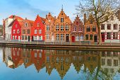 Scenic city view of Bruges canal with beautiful houses