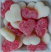 Red And White Gummy Hearts In Bowl On White