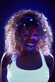 foto of uv-light  - Portrait of funny young woman with ice candy in neon light - JPG