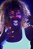 stock photo of uv-light  - Portrait of curly girl with ice cube in neon light - JPG