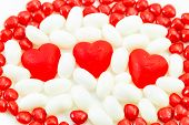 pic of jelly beans  - Valentine candies of June and Cinnamon Hearts and white jelly beans on white background - JPG