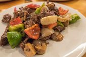 Ostrich Stir-fried with Black Pepper