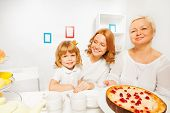 Cake with granny mother and little girl