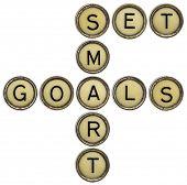 set smart goals  - motivational text in old round typewriter keys isolated on white