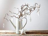 Hanging white Christmas stars on white background