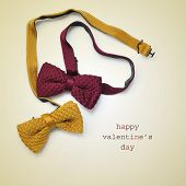 two bow ties, one of them forming a heart, and the text happy valentines day written on a beige background
