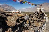 Stupa and player flags near Diskit monastery in Ladakh, Jammu & Kashmir, India - September 2014