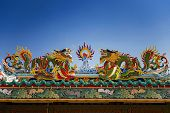 colorful dragon statue on the roof Chinese temple in Tak Province ,Thailand - January 2015