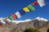 Snow mountain range and Player flag LADAKH, INDIA - September ,2014
