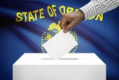 Voting Concept - Ballot Box With Us State Flag On Background - Oregon