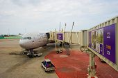 PHUKET, THAILAND - NOV 07: jet aircraft docked at airport on November 07, 2014. Phuket International Airport is an airport serving Phuket Province. It is the second busiest airport in Thailand