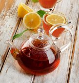 Hot  Tea  And Fresh Lemon Slices On A  Wooden Table