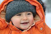 Smiling Baby With Snow In Winter