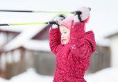 child goes skiing