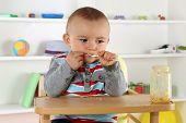 Child Eating Baby Food Porridge With Spoon