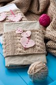 Two Old Pads In Knitted Cover With Felt Hearts Lie Next To The Coil Bright Filaments And Blanket Kni