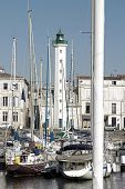 Lighthouse white of La Rochelle, port of La Rochelle and masts of boats (Charente-Maritime France)