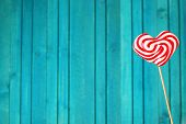 Heart Shaped Lollipop For Valentine's Day With Turquoise Background