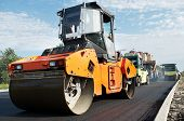 stock photo of vibrator  - Group of compactors and Heavy Vibration rollers at asphalt pavement works  - JPG