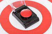 Red Button Over Dartboard