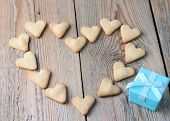 Heart Shape Cookies With Blue Gift Box On A Wooden Table For Valentine's Day